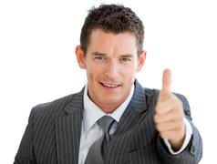 Assertive businessman with a thumb up - stock photo