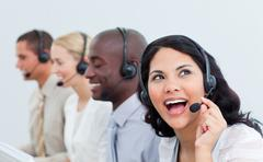 Animated businesswoman and her team working in a call center Stock Photos