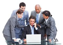 Assertive manager on phone and his team Stock Photos