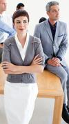 Assertive manager with folded arms in front of her team Stock Photos