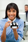 Self-assured businesswoman holding a business card holder - stock photo