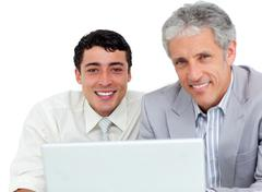 Self-assured business co-workers using a laptop Stock Photos