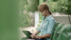 Young woman checking email on digital tablet computer Stock Footage