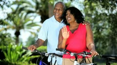 Diverse couple keeping fit and healthy cycling  - stock footage