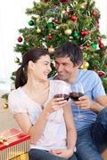lovers drinking wine at homa at christmas time - stock photo