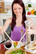 positive woman eating her healthy meal at home - stock photo