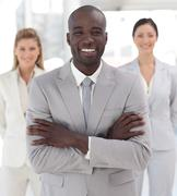 Stock Photo of positive afro-american manager with his team