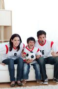 animated family watching a football match - stock photo