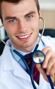 glowing doctor holding a stethoscope - stock photo