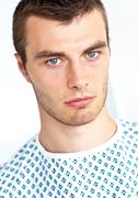 young unhappy patient looking at camera - stock photo