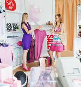 teen women choosing clothes together - stock photo