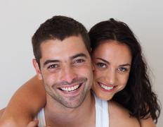 portrait of a blissful couple against white background - stock photo