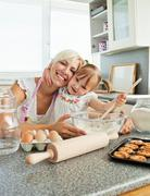 Stock Photo of laughing woman baking cookies with her daughter