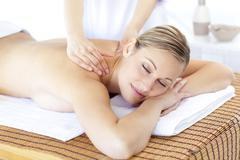 positive woman having a back massage - stock photo