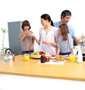 jolly young family having a breakfast - stock photo