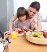 smiling mother and her child having breakfast - stock photo