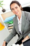 self-assured female architect looking at the camera - stock photo
