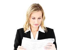 Anxious businesswoman holding a newspaper Stock Photos