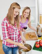 Delighted friends cooking spaghetties Stock Photos