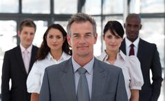 portrait of a confident business team looking at the camera - stock photo