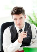 Portait of a self-assured businessman holding glasses Stock Photos