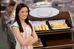 self-assured female cook smiling at the camera - stock photo