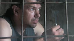Male behind bars Stock Footage