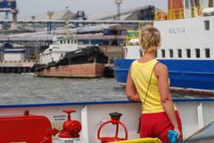 Girl on boat - stock photo