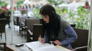 Stock Video Footage of Businesswoman working with documents in cafe HD