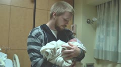 New father with newborn infant Stock Footage
