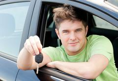 animated caucasian man holding a car key - stock photo
