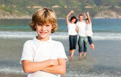 smiling family enjoying the stroll - stock photo