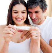 Stock Photo of blissful couple finding out results of a pregnancy test
