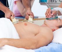 Close-up of a medical team resuscitating a patient Stock Photos