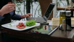 Businesswoman working on laptop and eating lunch in the cafe HD Stock Footage