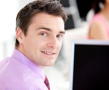 Stock Photo of portrait of an assertive businessman looking at the camera