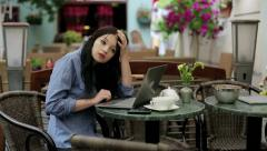 Tired attractive businesswoman with laptop in cafe HD Stock Footage