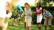 Ethnic happy family playing baseball on vacation  Stock Footage