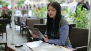 Businesswoman working with tablet computer and documents in cafe HD Stock Footage