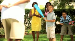 Healthy diverse family playing baseball outdoors   - stock footage