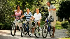 Ethnic family cycling fitness on vacation  Stock Footage