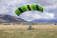 Green power parachute after landing Stock Photos