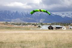 Power parachute landing in field - stock photo