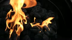 Flaming charcoal brickets Stock Footage