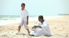 Ethnic parent relaxing beach with son   Stock Footage