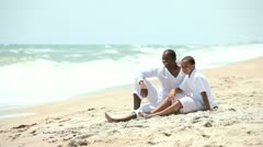 Loving ethnic father talking with son on beach  - stock footage