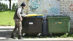 Tramp digging in dumpster - stock footage