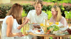Family sharing healthy lunch in garden  Stock Footage