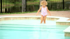 Little girl enjoying swimming pool   Stock Footage