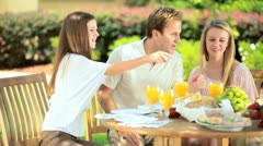 Family eating healthy fresh food outdoors  Stock Footage